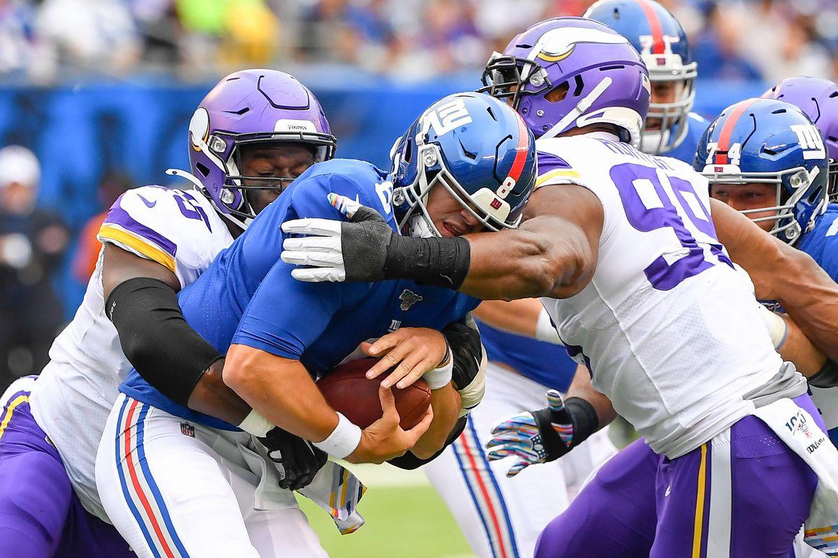 New York Giants quarterback Daniel Jones is sacked by Minnesota Vikings defensive ends Ifeadi Odenigbo and Danielle Hunter in the 1st half at MetLife Stadium.