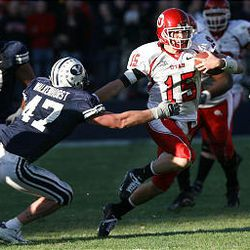 Utah's Brett Ratliff avoids a tackle by BYU's Paul Walkenhorst as the Utes beat BYU 41-34 in overtime during the latest installment of their rivalry played in Provo.