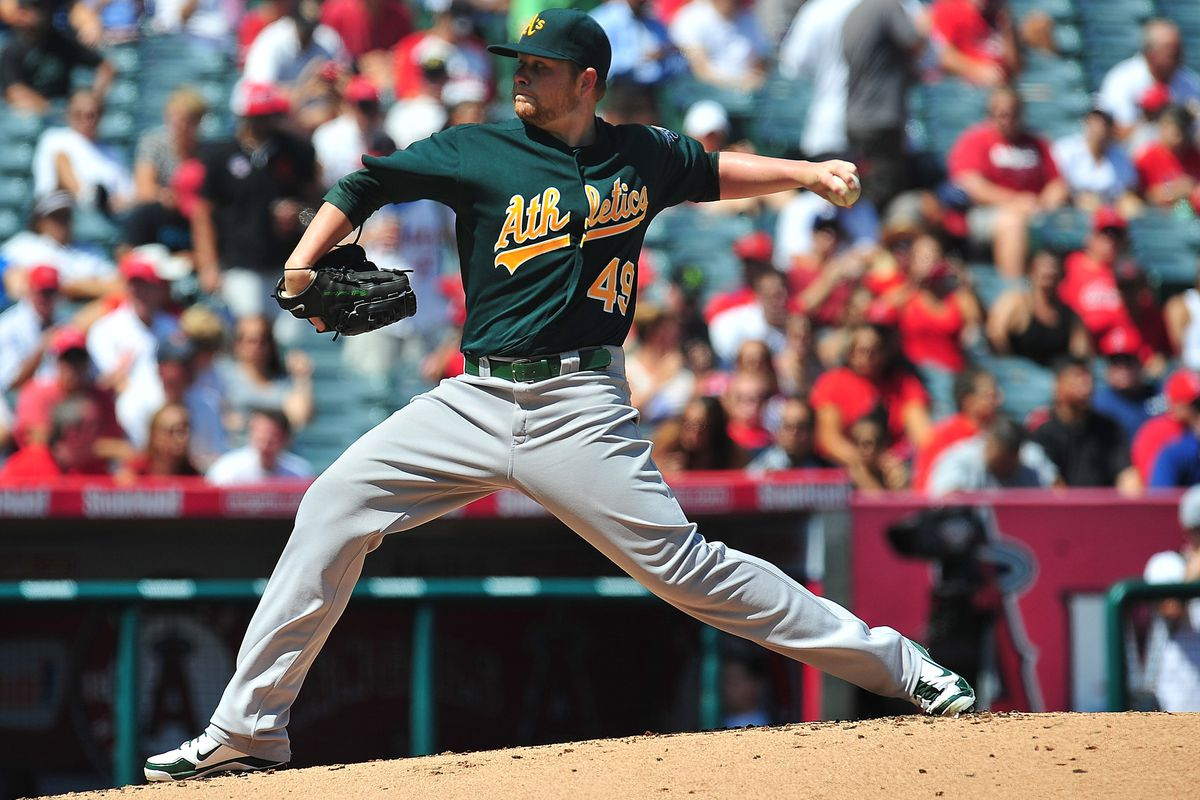 September 13, 2012; Anaheim, CA, USA; Oakland Athletics starting pitcher Brett Anderson (49) pitches in the first inning against the Los Angeles Angels at Angel Stadium. Mandatory Credit: Gary A. Vasquez-US PRESSWIRE