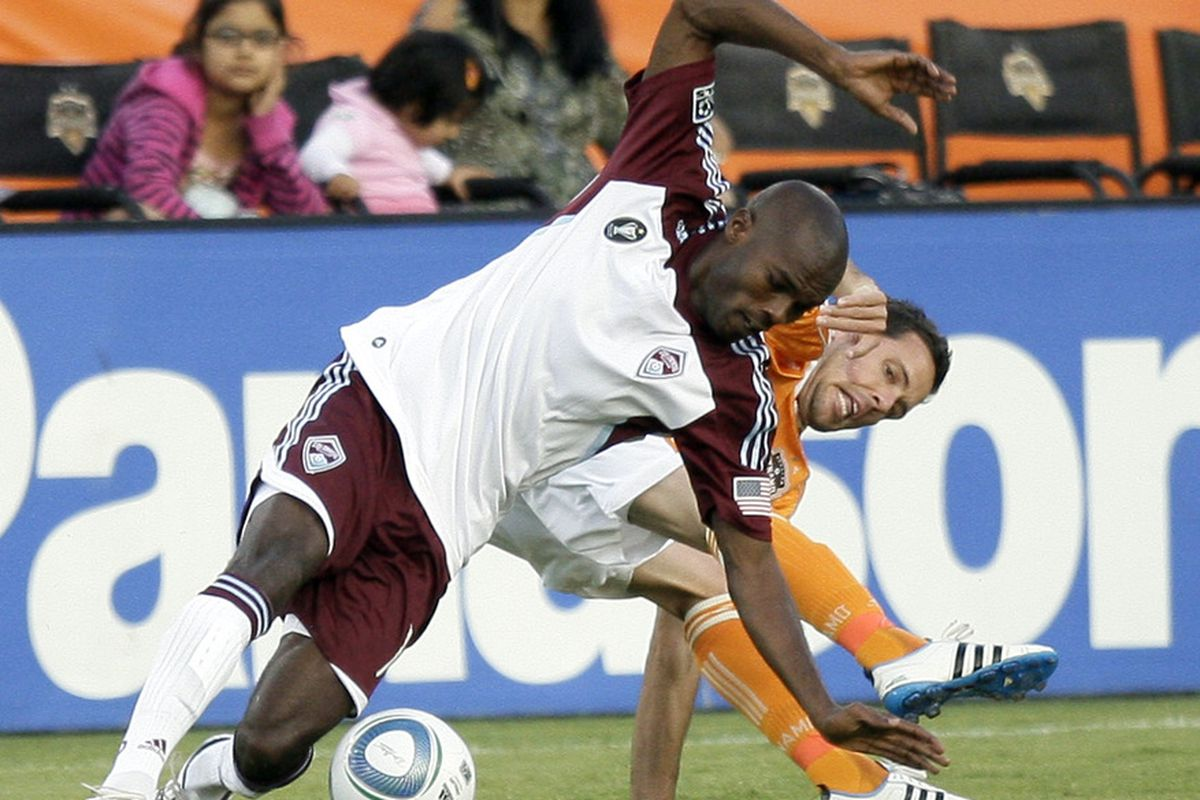HOUSTON - MAY 04:  Omar Cummings #14 of the Colorado Rapids and Hunter Freeman #21 of the Houston Dynamo battle for possession of the ball in the first half at Robertson Stadium on May 4, 2011 in Houston, Texas.  (Photo by Bob Levey/Getty Images)