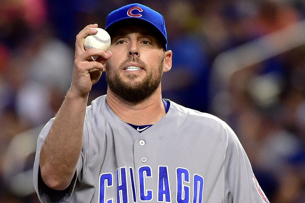 John Lackey attempts to hypnotize a baseball into doing his bidding. Clearly, it did not work