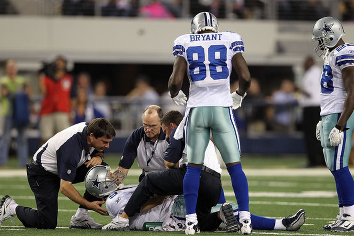 Tony Romo lies on the turf, unaware of the repercussions his injury would have for the Dallas defense.
