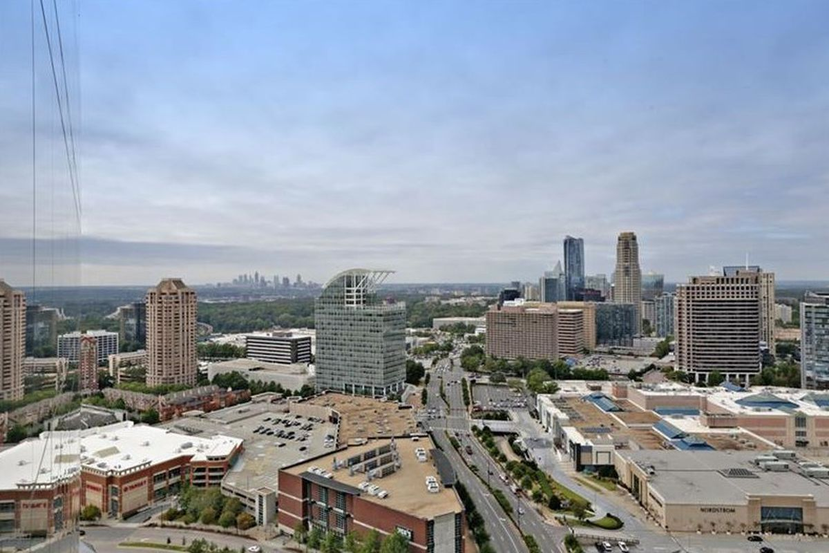 A photo from a condo with central Buckhead in the foreground, with Midtown and downtown in the distance.