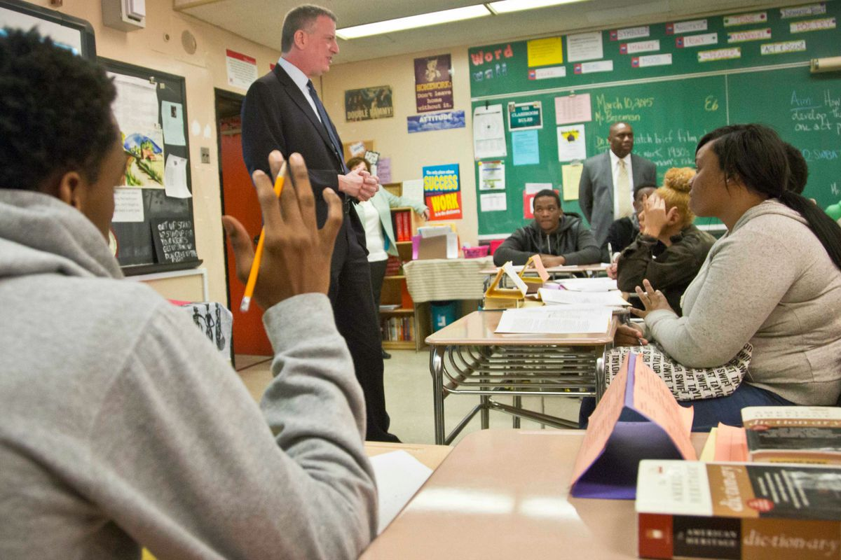 Mayor Bill de Blasio visited Boys and Girls High School in March 2015 and touted its progress under Wiltshire.