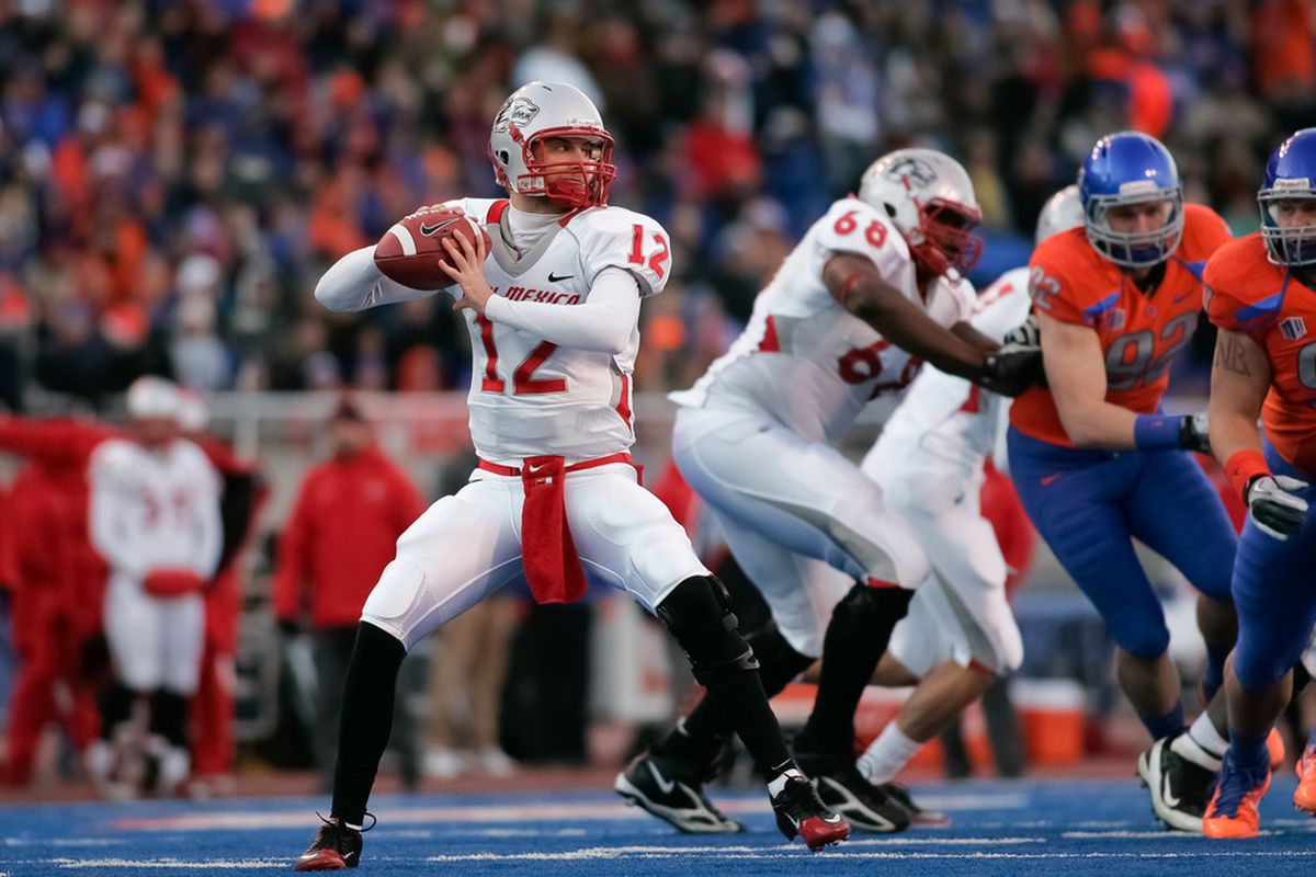 BOISE, ID - DECEMBER 03: B.R. Holbrook #12 of the New Mexico Lobos looks for a receiver against the Boise State Broncos at Bronco Stadium on December 3, 2011 in Boise, Idaho.  (Photo by Otto Kitsinger III/Getty Images)