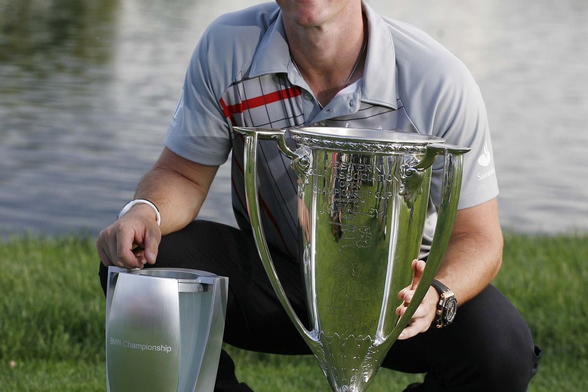 Sep 9, 2012; Carmel, IN, USA; Rory McIlroy poses with both the Western Golf Association Open Championship Cup and the BMW Championship Trophy after winning the BMW Championship at Crooked Stick Golf Club. Mandatory Credit: Brian Spurlock-US PRESSWIRE