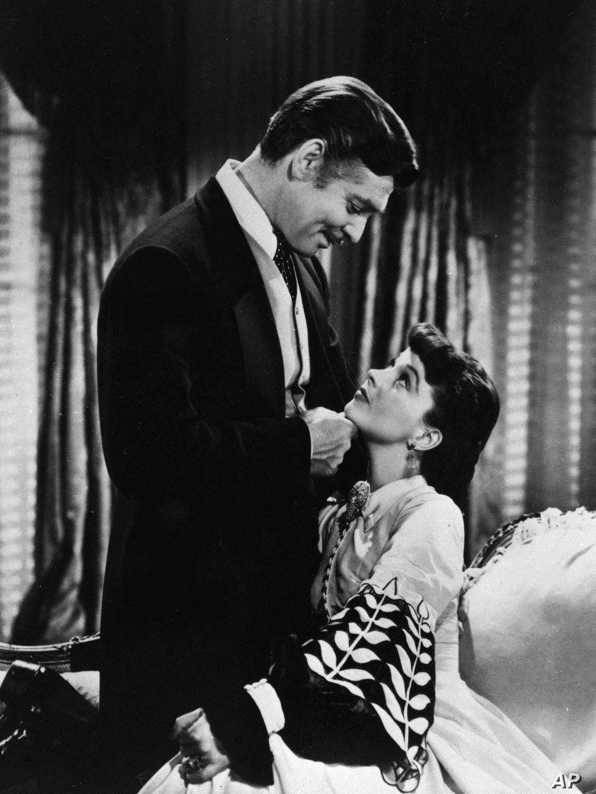 Clark Gable as Rhett Butler condescendingly chucks Scarlett O'Hara's chin in Gone With the Wind