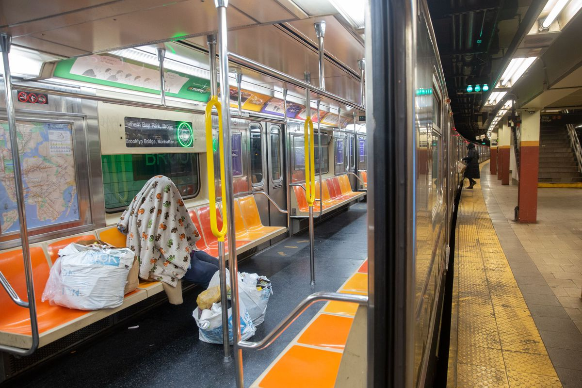 A person sleeps on a 6 train during the coronavirus outbreak.
