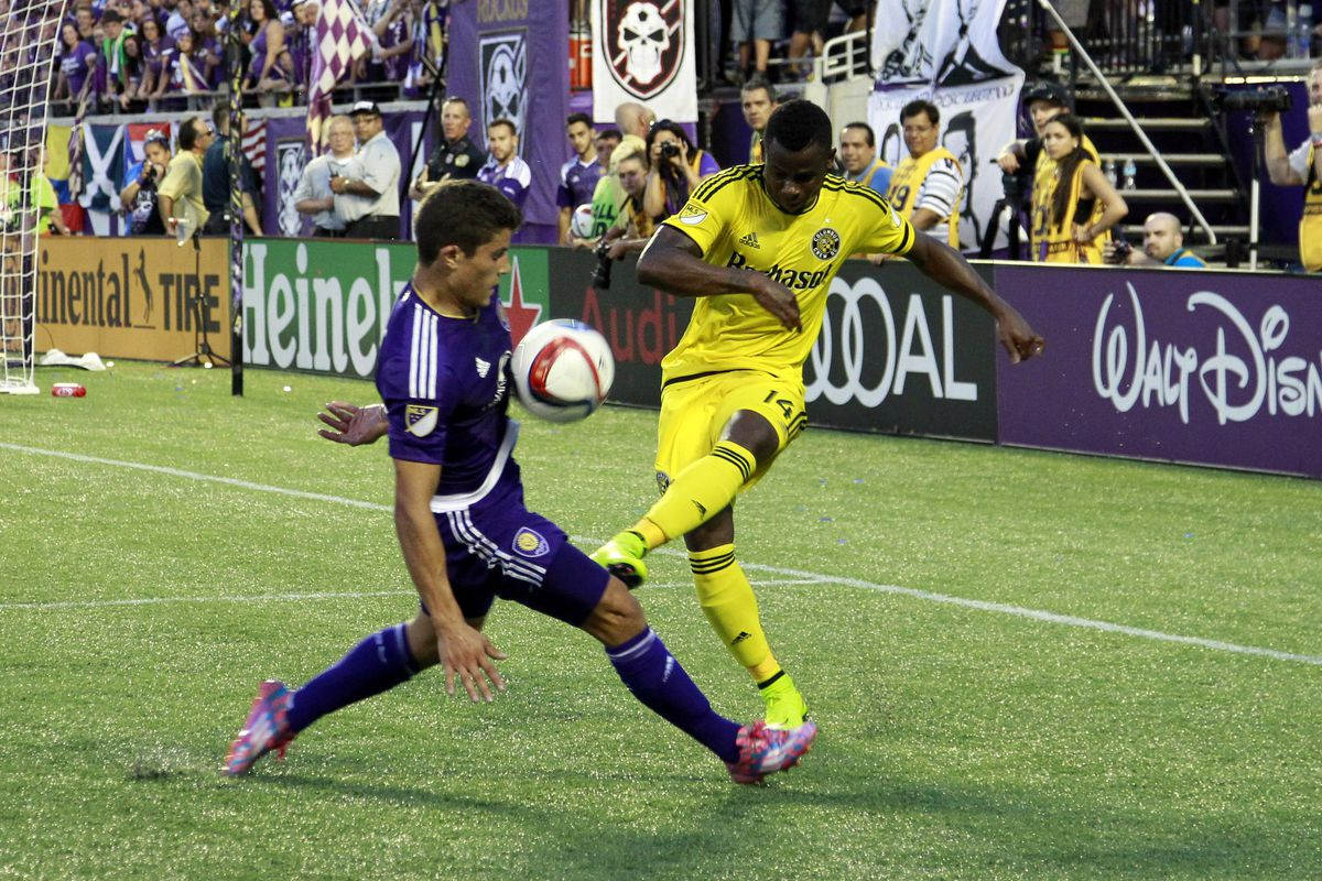 Columbus' Waylon Francis tries to get the ball around Orlando City's Rafael Ramos in a 2-2 draw Saturday.