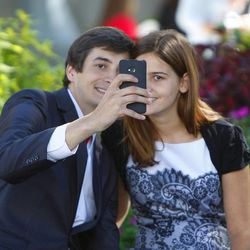 Zach Hoopes and Kasha Curtis their their photo during the afternoon session of the 183rd Semiannual  General Conference of the Church of Jesus Christ of Latter-day Saints Sunday, Oct. 6, 2013, in Salt Lake City.