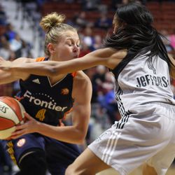 Connecticut Sun's Jaime Weisner (4) is guarded closely by San Antonio Stars' Moriah Jefferson (4).