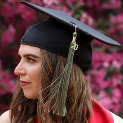 Sophia Vitale poses for a photo on the University of Utah's campus before a virtual commencement ceremony on Thursday, April 30, 2020. Vitale, a triplet, went to campus with her siblings, one of whom has also completed a bachelor's program at the university this year.