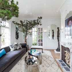 """A common theme in this year's home was bringing the outdoors in. These 60-year-old Monterey Pines in custom containers are a good example. [Photo by <a href=""""http://www.patriciachangphotography.com/"""">Patricia Chang</a>]"""