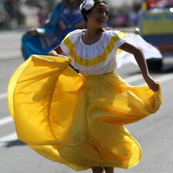 Gisselle Fajardo dances in the Days of '47 Youth Parade in Salt Lake City on Saturday, July 20, 2013.