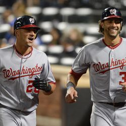 Washington Nationals' Ian Desmond, left, and Michael Morse return to the dugout after Desmond drove in Morse with a two-run home run in the fourth inning of the baseball game against the New York Mets in New York, Monday, Sept. 10, 2012.