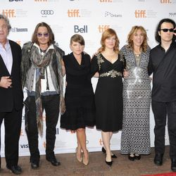 """From left, Sony Pictures Classics co-president Tom Bernard, actor Johnny Depp, musician Natalie Maines, producer Lorri Davis, director Amy Berg, and producer Damien Echols attend the """"West of Memphis"""" film premiere at Ryerson Theatre during the Toronto International Film Festival on Saturday Sept. 8, 2012 in Toronto."""