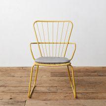 Yellow steel armchair with grey cushion
