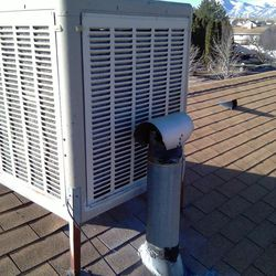 This flue is immediately adjacent to the swamp cooler.