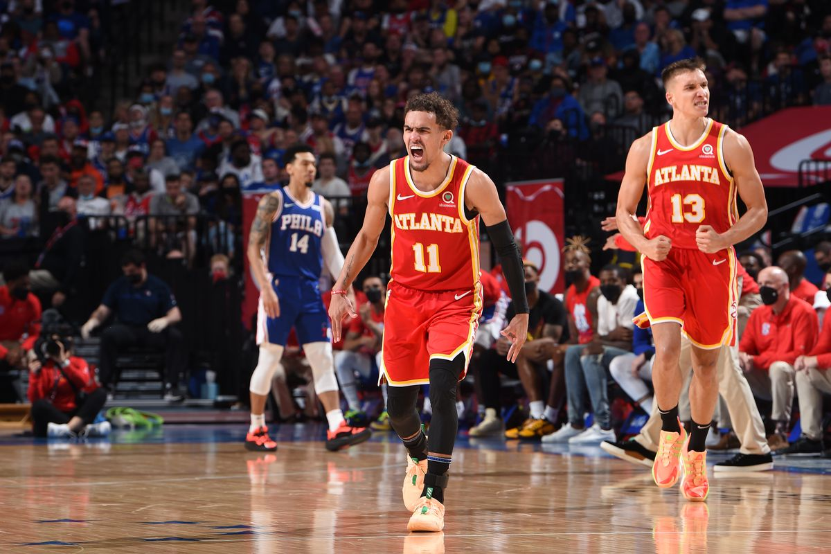 Trae Young of the Atlanta Hawks and Bogdan Bogdanovic of the Atlanta Hawks react during a game against the Philadelphia 76ers during Round 2, Game 2 of the Eastern Conference Playoffs on June 8, 2021 at Wells Fargo Center in Philadelphia, Pennsylvania.