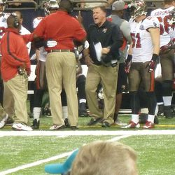 Greg Schiano breaking up a fight between his coach and players.