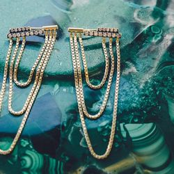 18 karat gold 'Revival' earrings with pavé diamonds and draping chains, $5,040