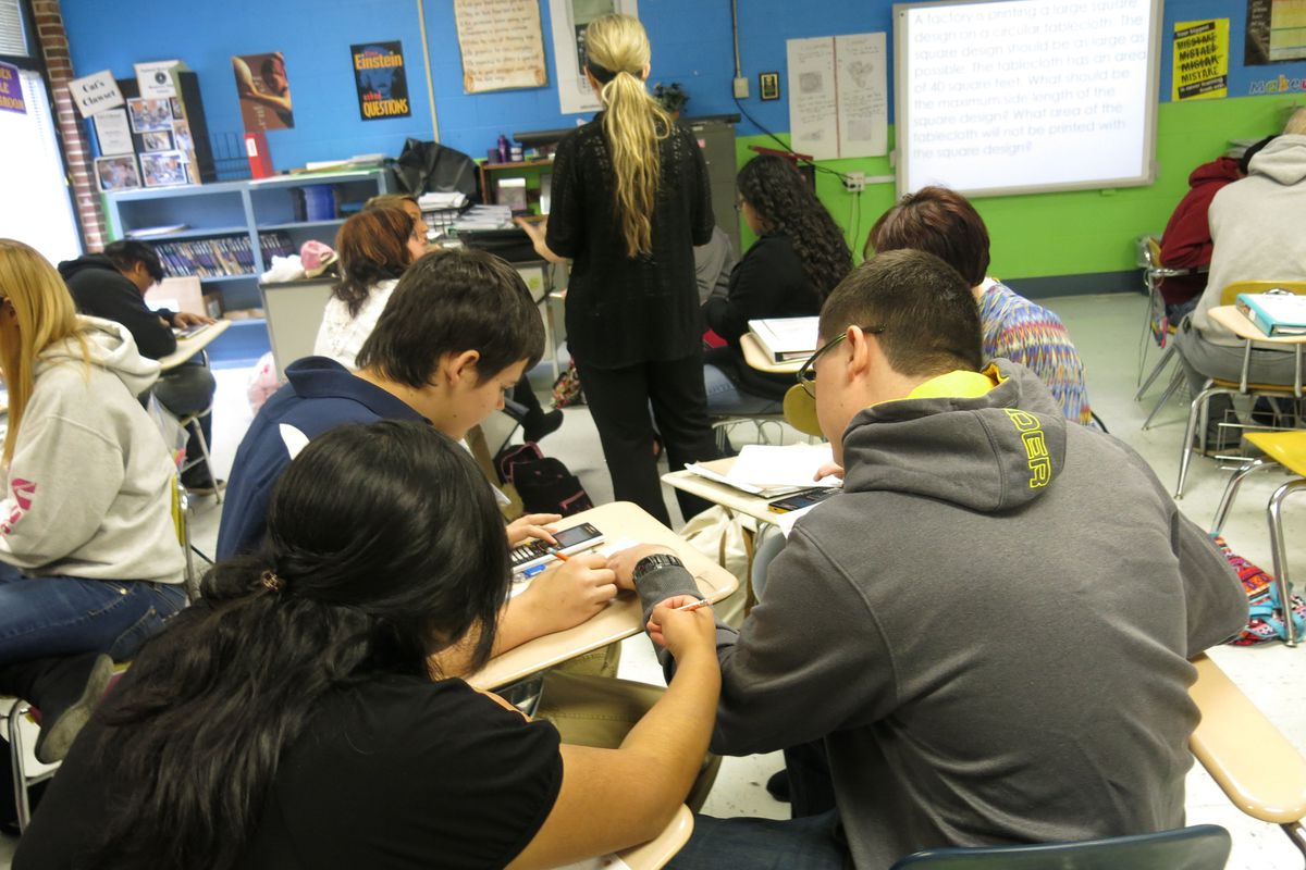Students in Christin Root's Integrated Math I class at Monterey High School work in groups on a  word problem. The Putnam County school was one of the first in the state to switch to an integrated math approach.