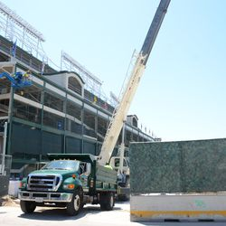 11:44 a.m. Crane unloading supplies in the triangle lot -