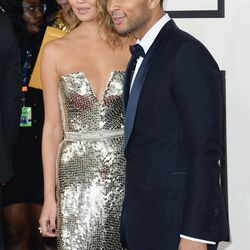 Chrissy Teigan looking glam in Johanna Johnson with John Legend in Gucci.