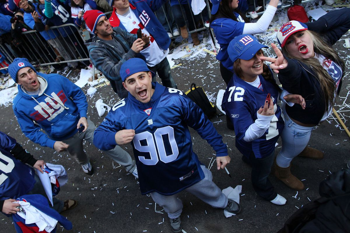 NEW YORK, NY - FEBRUARY 07:  People cheer during the New York Giants' Victory Parade on February 7, 2012 in New York City. The Giants defeated the New England Patriots 21-17 in Super Bowl XLVI.  (Photo by Andrew Burton/Getty Images)