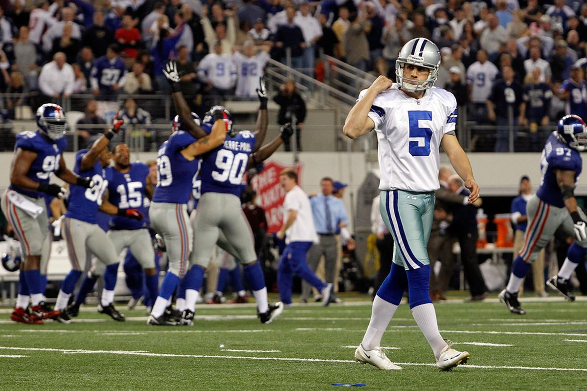 The New York Giants celebrate a 37-34 win after Dan Bailey of the Dallas Cowboys missed the game tying field goal in the final seconds of the game at Cowboys Stadium on December 11, 2011 in Arlington, Texas.  (Photo by Tom Pennington/Getty Images)
