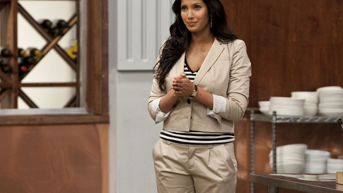 743a251c7536 Padma Lakshmi in a khaki suit on Top Chef Bravo/Getty