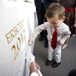 Jacob Purcell does his best to apply mortar around the cornerstone. About 200 took part in the ceremony at the Brigham City Temple prior to the dedication Sunday, Sept. 23, 2012.
