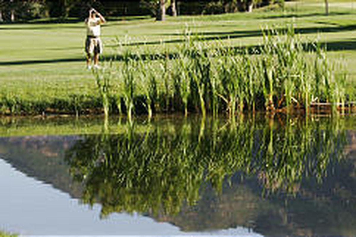 Caddy Todd Montoya scouts the Willow Creek Country Club course prior to this week's tournament.