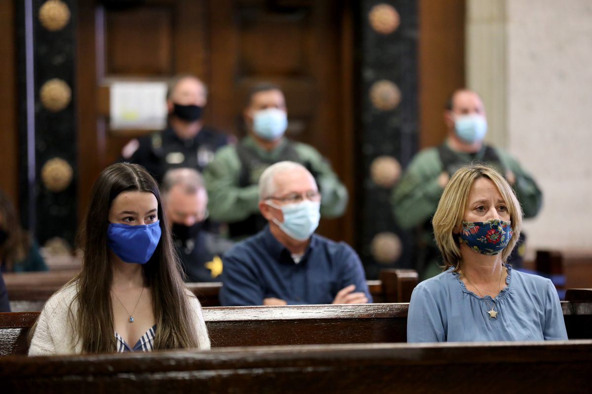 The late Chicago Police Cmdr. Paul Bauer's daughter, Grace, and wife, Erin Bauer, watch as Shomari Legghette, 47, is sentenced.