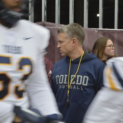 Head coach Jason Candle watches intensely as the Rockets run onto the field.