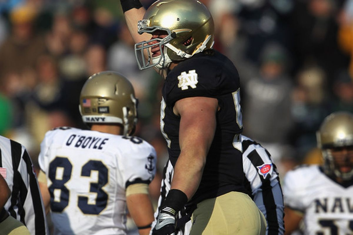 Troy Niklas holds up the ball after recovering a fumble against Navy in 2011. Notre Dame defeated Navy 56-14. Will they dominate the Midshipmen again in 2012?