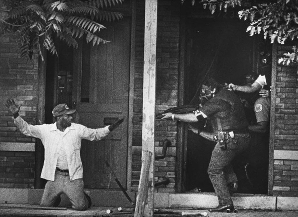 One of the best-known photographs Bob Ringham shot as a Chicago Sun-Times photographer shows Tommie Lee Hudson surrendering the the police at 7237 S. Stony Island on July 14, 1988, after shooting two people. | Bob Ringham / Sun-Times