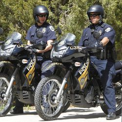 University Police on motorcycles stand watch at the University of Colorado in Boulder, Colo., on Friday, April 20, 2012. The university closed the campus to prohibit an annual 420 marijuana smoke out.