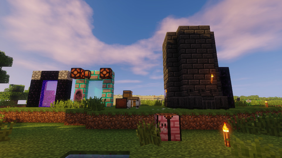 Several portals, chests, and a large forge in Minecraft
