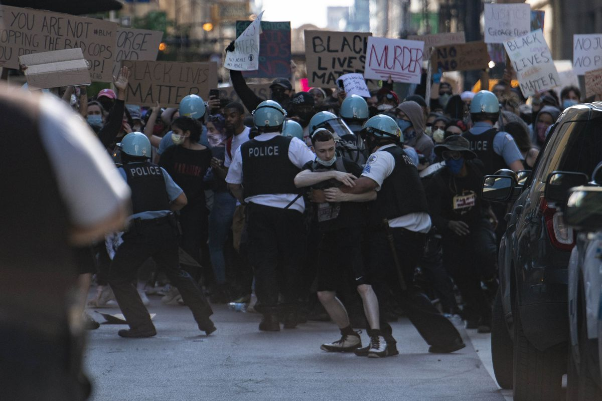 Chicago police and protesters scuffle near Daley Plaza, Saturday, May 30, 2020.