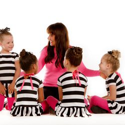 Katie Parker, seen here with the young performers she teaches, is the CEO of Singers Company, and she still teaches classes at home in California.