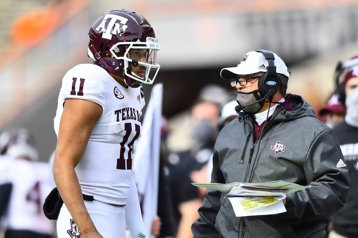 Texas A&M quarterback Kellen Mond (11) speaks to Texas A&M head coach Jimbo Fisher during a game between Tennessee and Texas A&M in Neyland Stadium in Knoxville, Saturday, Dec. 19, 2020.