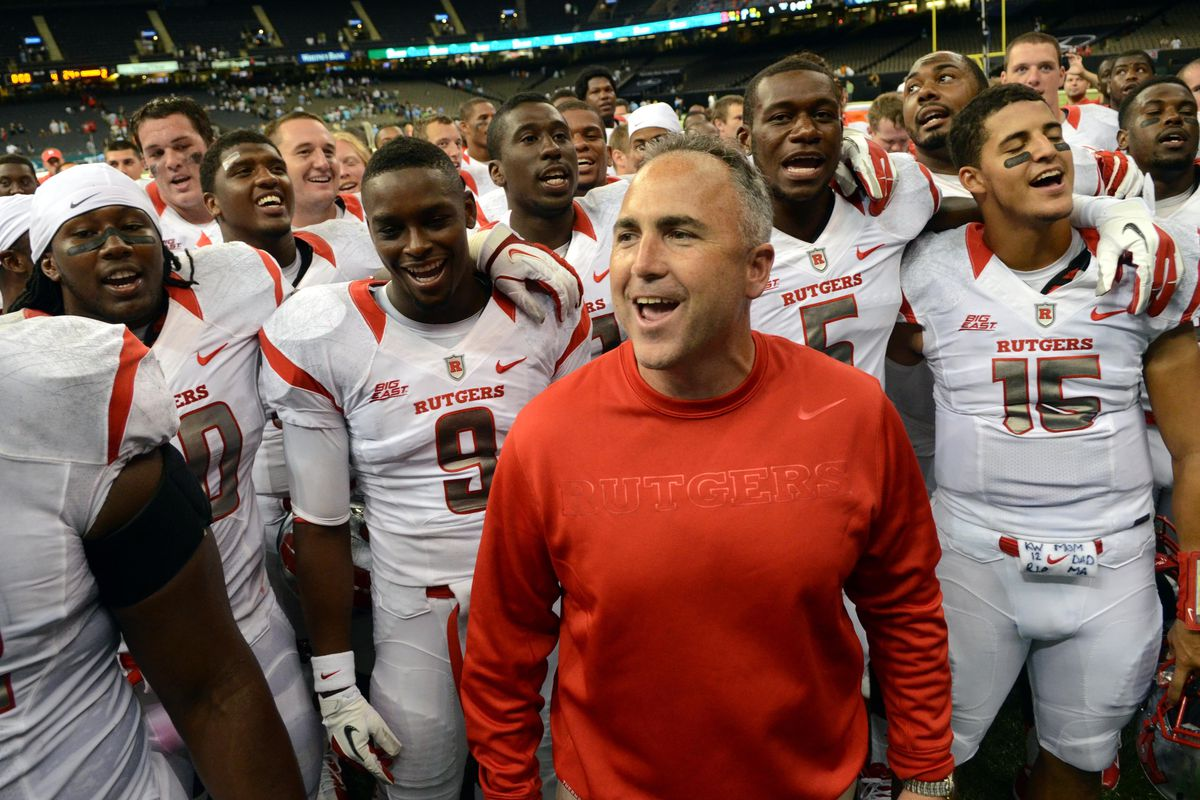 September 1, 2012; New Orleans, LA, USA; Rutgers Scarlet Knights head coach Kyle Flood celebrates a 24-12 win against the Tulane Green Wave with his players after their game at the Mercedes-Benz Superdome. Chuck Cook - US PRESSWIRE