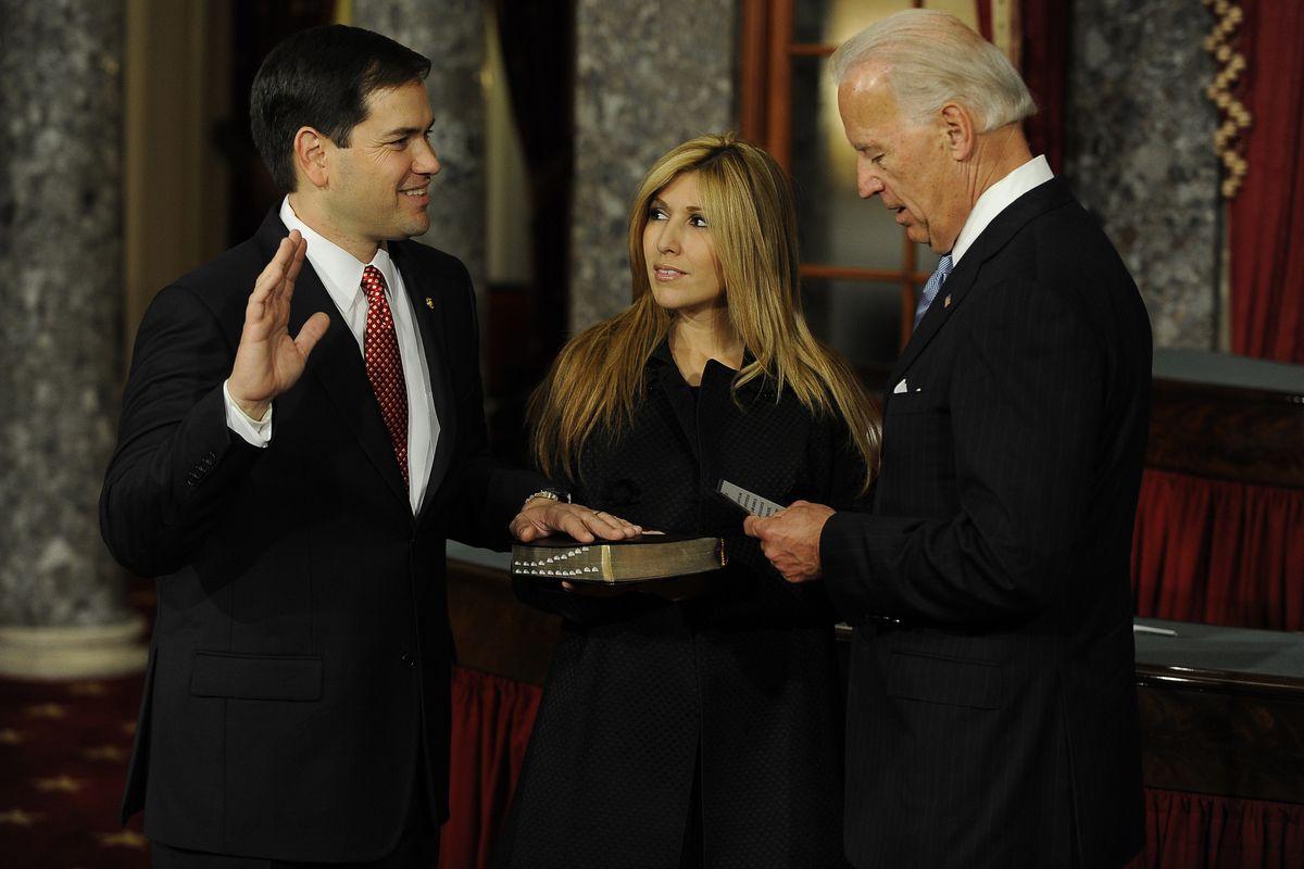 Vice President Joe Biden, right, swears in first-term Sen. Marco Rubio, left, in the US Capitol in January 2011.