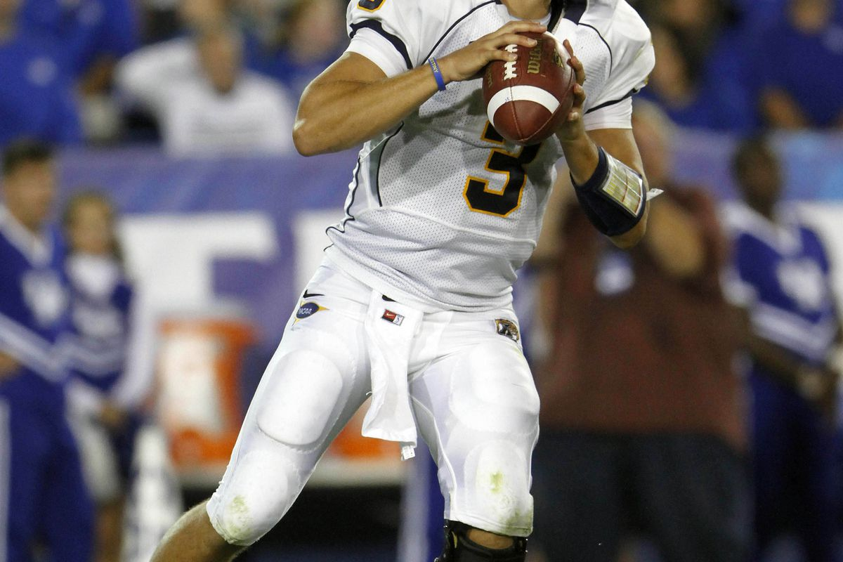 Sept 8, 2012; Lexington, KY, USA; Kent State Golden Flashes quarterback Spencer Keith (3) passes the ball against the Kentucky WIldcats at Commonwealth Stadium. Credit: Mark Zerof-US PRESSWIRE