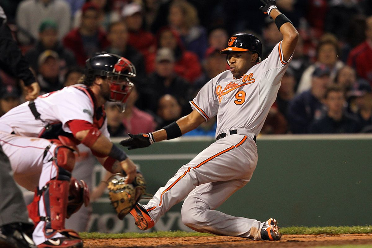 BOSTON, MA - JUNE 5:  Endy Chavez #9 of the Baltimore Orioles scores a run in the seventh inning against the Boston Red Sox at Fenway Park June 5, 2012  in Boston, Massachusetts. (Photo by Jim Rogash/Getty Images)