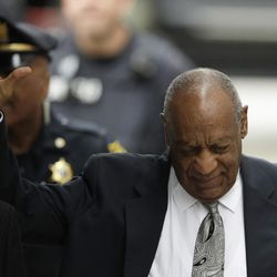 Bill Cosby waves as he arrives at the Montgomery County Courthouse during his sexual assault trial, Saturday, June 17, 2017, in Norristown, Pa.