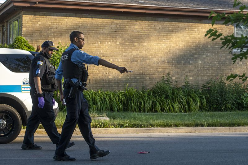 Chicago police work the scene where 2 women were wounded in a shooting in the 9800 block of S Lowe Ave, in the Longwood Manor neighborhood, Saturday, June 5, 2021.