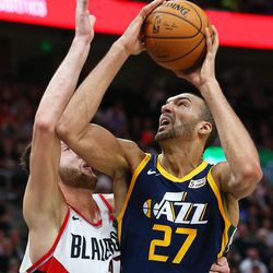 Utah Jazz center Rudy Gobert (27) goes up for a shot with Portland Trail Blazers center Jusuf Nurkic (27) as the Utah Jazz and the Portland Trailblazers play at Vivint Arena in Salt Lake City on Wednesday, Nov. 1, 2017. Utah won 112-103 in Overtime.