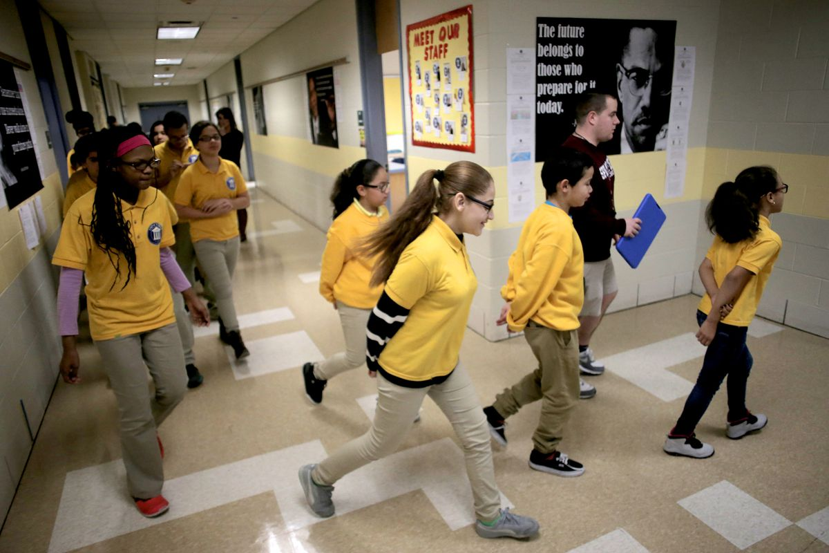Students transition to gym class from Zoe Pierce's sixth grade science class at the Impact School in Springfield, Massachusetts in January 2017. Working with state officials, Springfield education leaders have crafted a first-of-its-kind plan for a Massachusetts school system, spinning off the middle schools into what effectively is their own miniature school system.